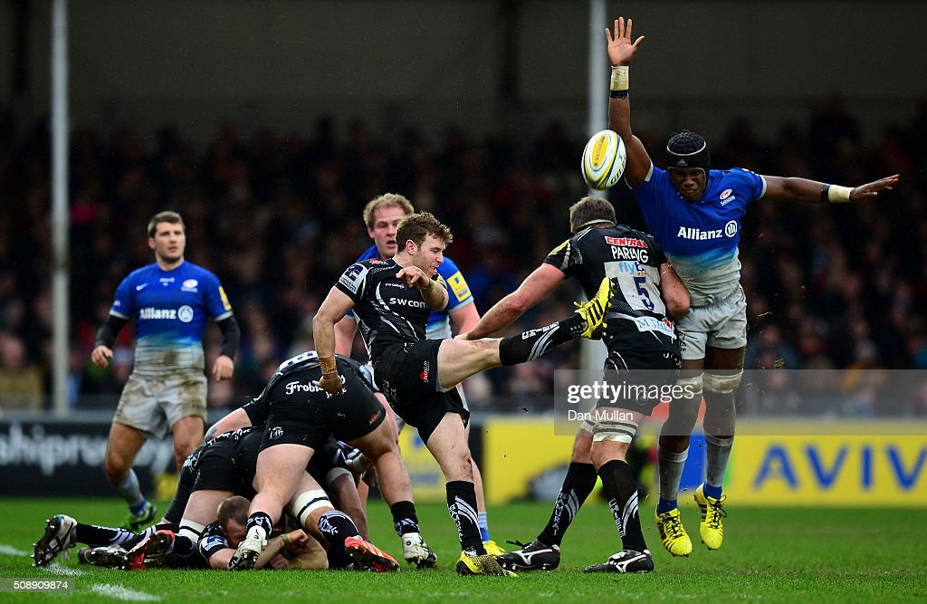 Will Chudley of Exeter Chiefs puts in a box kick under pressure from <a gi-track='captionPersonalityLinkClicked' href=/galleries/search?phrase=Maro+Itoje&family=editorial&specificpeople=5967858 ng-click='$event.stopPropagation()'>Maro Itoje</a> of Saracens during the Aviva Premiership match between Exeter Chiefs and Saracens at Sandy Park on February 7, 2016 in Exeter, England.