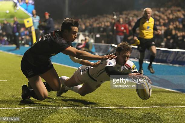 Will Chudley of Exeter Chiefs stopes Alex Lozowski of Saracens scoring a try during the Aviva Premiership match between Saracens and Exeter Chiefs at...