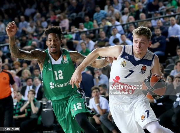 Will Clyburn of Darussafaka Dogus in action against Luka Doncic of Real Madrid during the Turkish Airlines EuroLeague Playoffs Game 4 between...