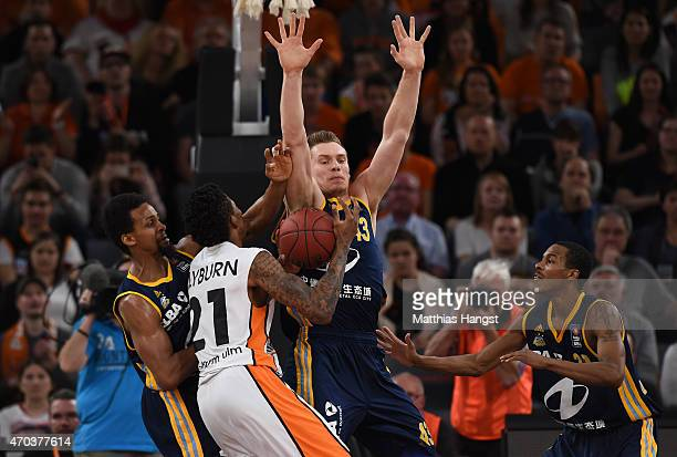 Will Clyburn of Ulm is blocked by Leon Radosevic of Berlin during the Beko Basketball Bundesliga match between Ratiopharm Ulm and Alba Berlin at...