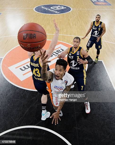 Will Clyburn of Ulm is challenged by Leon Radosevic of Berlin during the Beko Basketball Bundesliga match between Ratiopharm Ulm and Alba Berlin at...