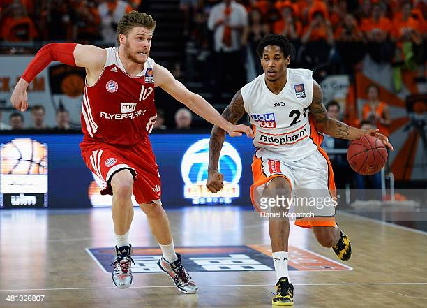 Will Clyburn of Ulm is challenged by Lucca Staiger of Muenchen during the Beko BBL Top Four 2014 semifinal match between FC Bayern Muenchen and...