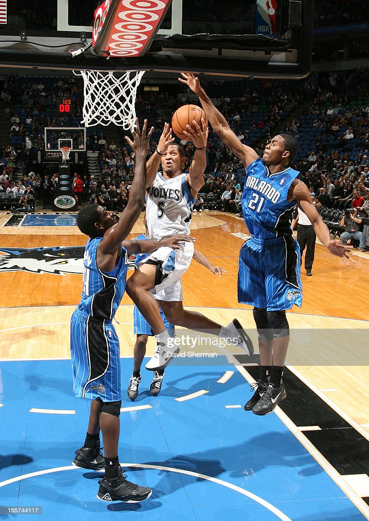 Will Conroy #5 of the Minnesota Timberwolves goes to the basket against Maurice Harkless #21 of the Orlando Magic during the game between the Minnesota Timberwolves and the Orlando Magic on November 7, 2012 at Target Center in Minneapolis, Minnesota.