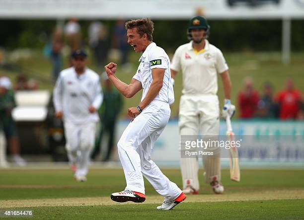 Will Davis of Derbyshire celebrates after taking the wicket of Adam Voges of Australia during day one of the Tour Match between Derbyshire and...