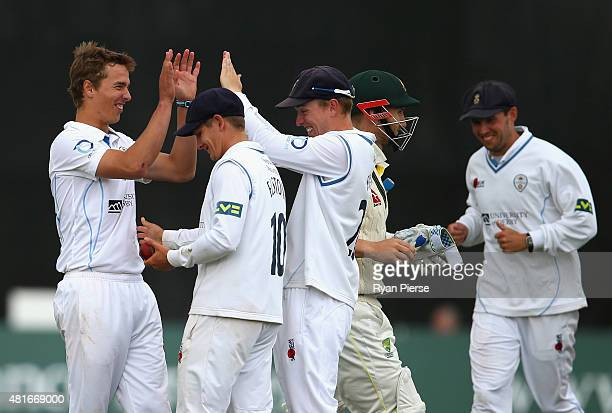 Will Davis of Derbyshire celebrates after taking the wicket of Peter Nevill of Australia during day one of the Tour Match between Derbyshire and...
