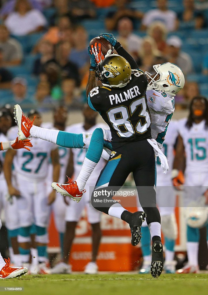 Will Davis #29 of the Miami Dolphins makes an interception over Tobais Palmer #83 of the Jacksonville Jaguars during a preseason game at EverBank Field on August 9, 2013 in Jacksonville, Florida.