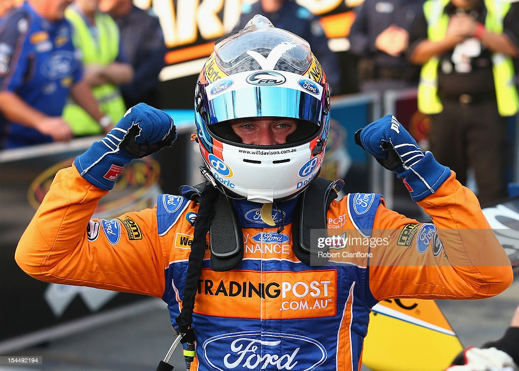 Will Davison driver of the #6 Tradingpost FPR Ford celebrates after he and co-driver Mika Salo of Finland won race 23 of the Gold Coast 600, which is round 12 of the V8 Supercars Championship Series at the Gold Coast Street Circuit on October 21, 2012 on the Gold Coast, Australia.