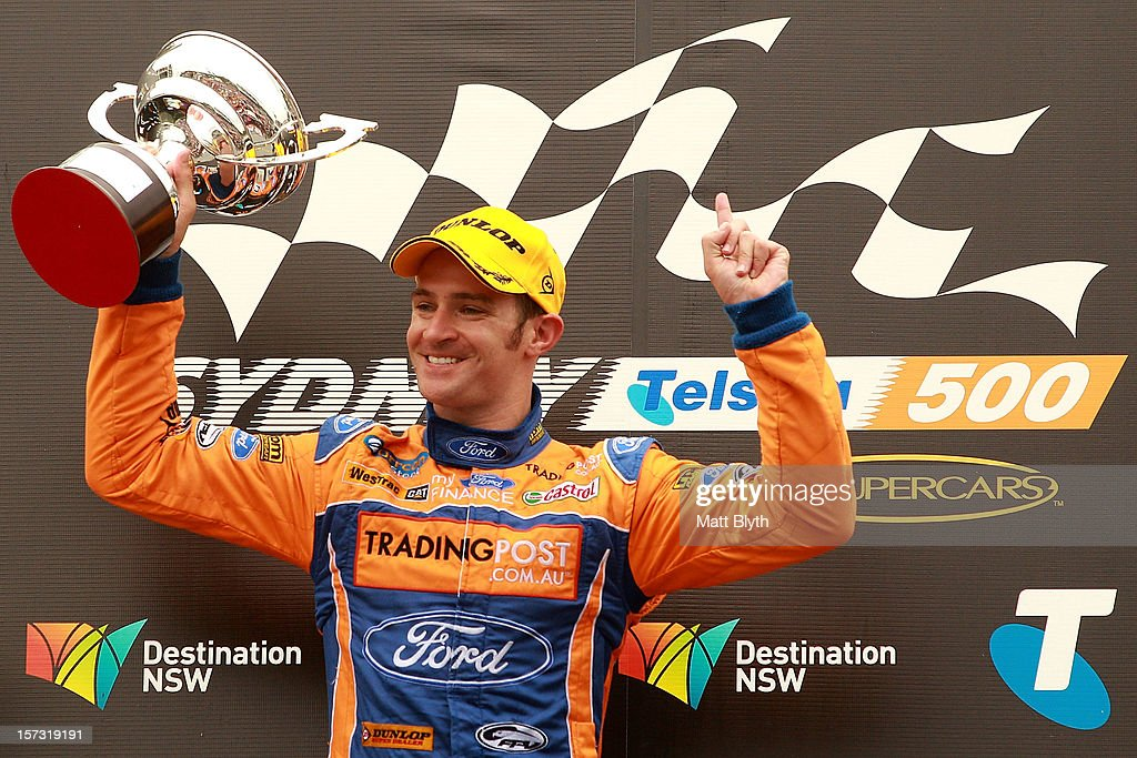Will Davison driver of the #6 Tradingpost FPR Ford celebrates winning race 30 during the Sydney 500, which is round 15 of the V8 Supercars Championship Series at Sydney Olympic Park Street Circuit on December 2, 2012 in Sydney, Australia.