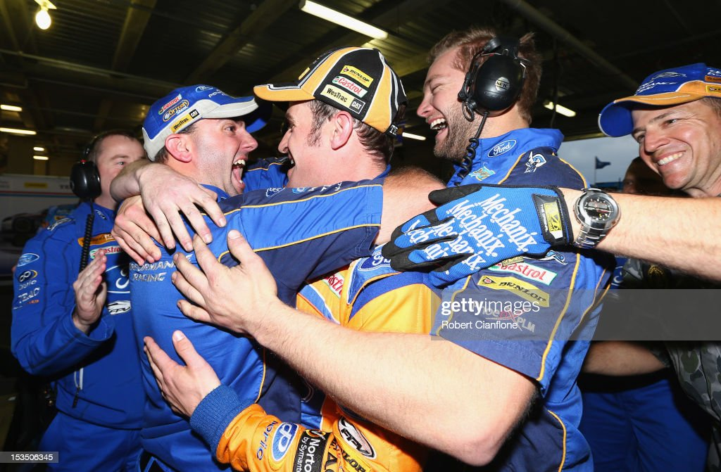Will Davison driver of the #6 Tradingpost FPR Ford celebrates with his teammates after taking pole position in the Top 10 shootout for the Bathurst 1000, which is round 11 of the V8 Supercars Championship Series at Mount Panorama on October 6, 2012 in Bathurst, Australia.