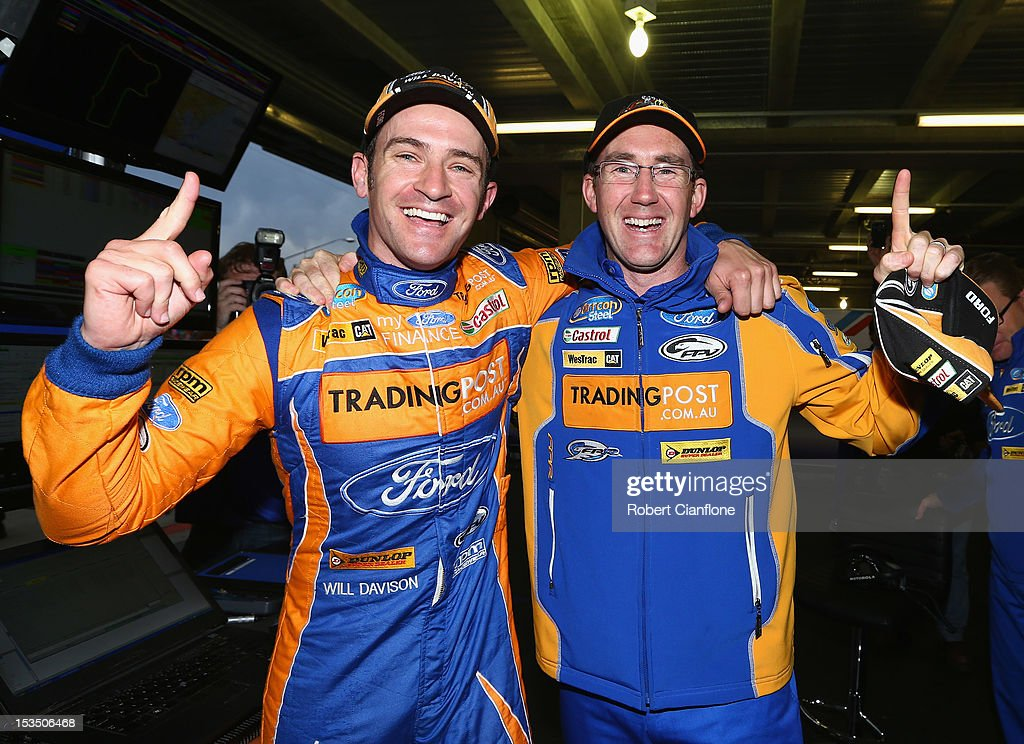Will Davison driver of the #6 Tradingpost FPR Ford celebrates with co-driver John McIntyre after taking pole position in the Top 10 shootout for the Bathurst 1000, which is round 11 of the V8 Supercars Championship Series at Mount Panorama on October 6, 2012 in Bathurst, Australia.