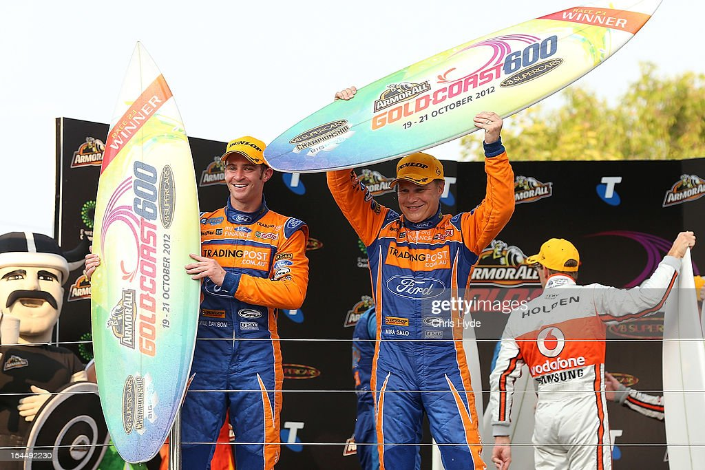 Will Davison (L) driver of the #6 Tradingpost FPR Ford celebrates with co-driver Mika Salo (R) of Finland won race 23 of the Gold Coast 600, which is round 12 of the V8 Supercars Championship Series at the Gold Coast Street Circuit on October 21, 2012 on the Gold Coast, Australia.