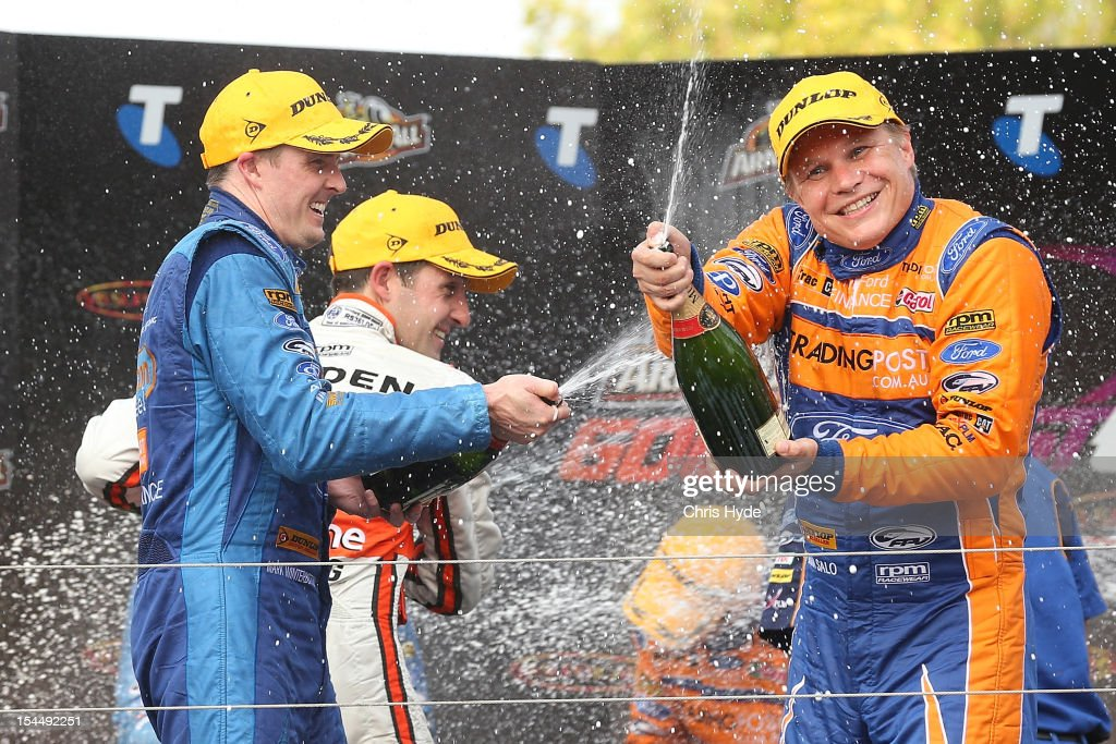 Will Davison (L) driver of the #6 Tradingpost FPR Ford celebrates with co-driver <a gi-track='captionPersonalityLinkClicked' href=/galleries/search?phrase=Mika+Salo&family=editorial&specificpeople=822179 ng-click='$event.stopPropagation()'>Mika Salo</a> (R) of Finland won race 23 of the Gold Coast 600, which is round 12 of the V8 Supercars Championship Series at the Gold Coast Street Circuit on October 21, 2012 on the Gold Coast, Australia.