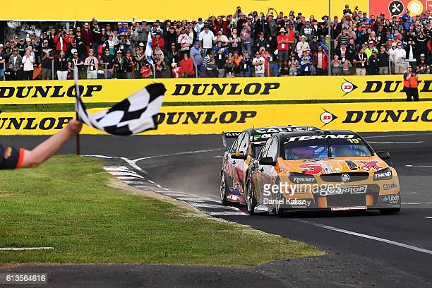 Will Davison drives the Tekno Autosports Holden Commodore VF takes the chequred flag to win the Bathurst 1000 which is race 21 of the Supercars...