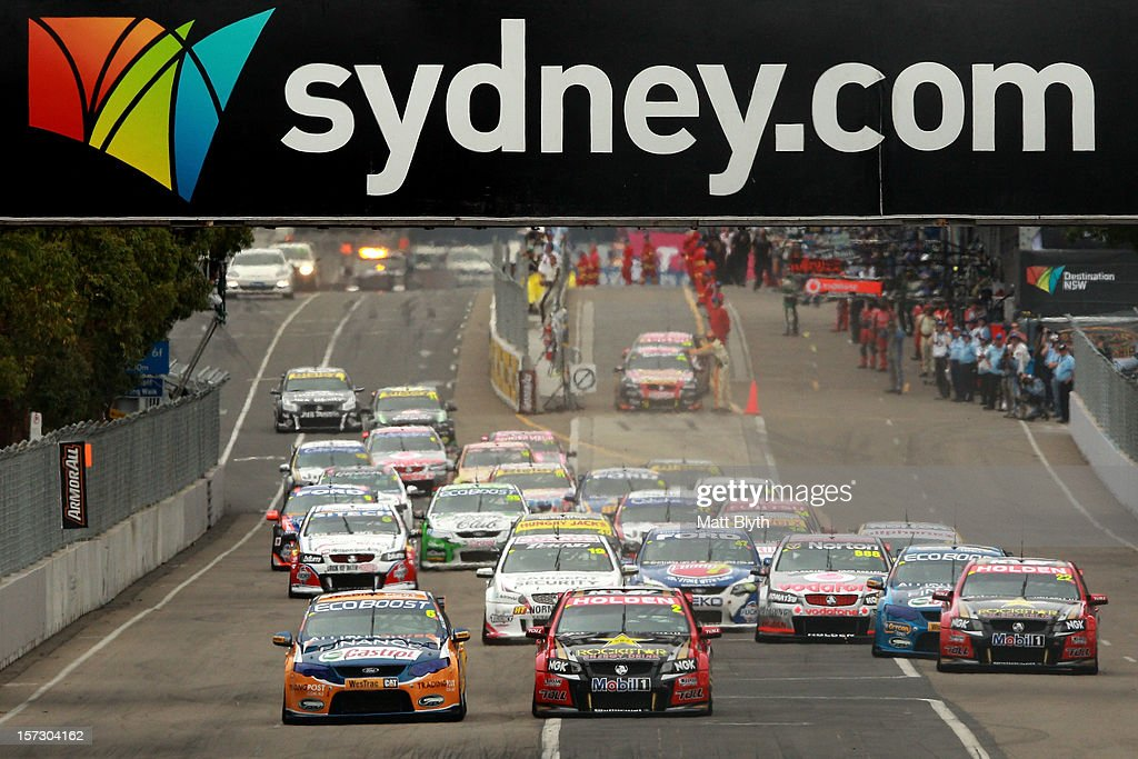 Will Davison (L) drives the #6 Tradingpost FPR Ford into turn one for the Sydney 500, which is round 15 of the V8 Supercars Championship Series at Sydney Olympic Park Street Circuit on December 2, 2012 in Sydney, Australia.