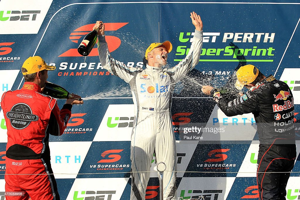 Will Davison of the Erebus Motorsport V8 team is sprayed with champagne by Fabian Coulthard of the Freightliner Racing team and Craig Lowndes of the...