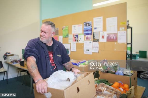 Will Eley a volunteer from the charity Transformation CPR carries a crate of food at the foodbank being run at the Camborne Centenary Methodist...