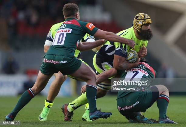 Will Evans of Leicester Tigers tackles Josh Strauss of Sale Sharks during the Aviva Premiership match between Leicester Tigers and Sale Sharks at...