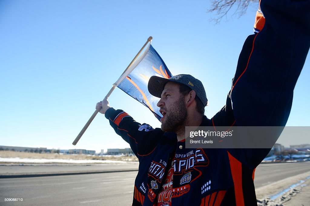 Will Everetts waves a Denver Broncos flag in front of Dove Valley on February 8, 2016 in Centennial, Colorado. Fans cheered for the Denver Broncos when they returned home after defeating the Carolina Panthers to win Super Bowl 50.