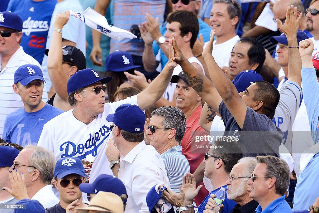 <a gi-track='captionPersonalityLinkClicked' href=/galleries/search?phrase=Will+Ferrell&family=editorial&specificpeople=171995 ng-click='$event.stopPropagation()'>Will Ferrell</a> high fives a fan at game five of the National League Championship Series at Dodger Stadium on October 16, 2013 in Los Angeles, California.