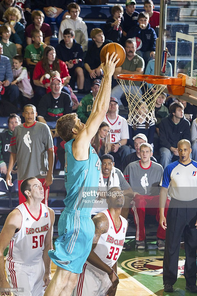 Will Foster #44 of the Sioux Falls Skyforce puts back an offensive rebound against the Maine Red Claws on December 2, 2012 at the Portland Expo in Portland, Maine.