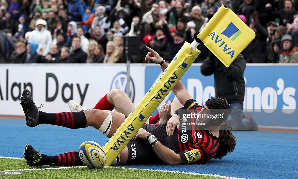 Will Fraser of Saracens celebrates after scoring a try during the Aviva Premiership match between Saracens and London Welsh at Allianz Park on March 03, 2013 in Barnet, England.