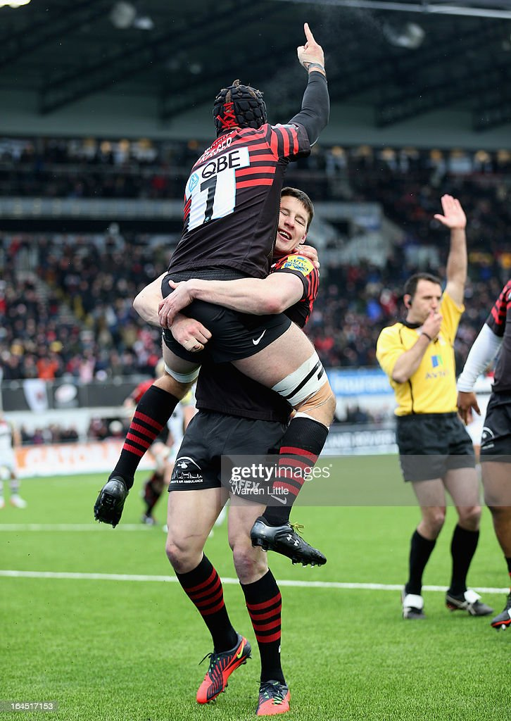 Will Fraser of Saracens is congratulated by Joel Tomkins after scoring a try during the Aviva Premiership match between Saracens and Harlequins at Allianz Park on March 24, 2013 in Barnet, England.