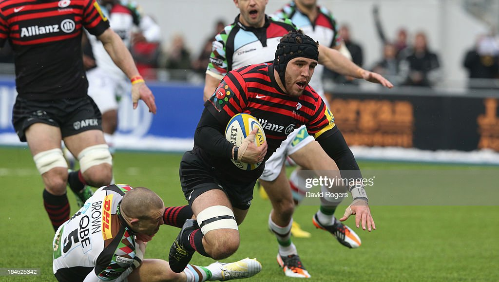 Will Fraser of Saracens is tackled by Mike Brown during the Aviva Premiership match between Saracens and Harlequins at Allianz Park on March 24, 2013 in Barnet, England.