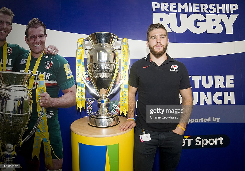 Will Fraser of Saracens stands with the Aviva Premiership Trophy during the 2013-14 Aviva Premiership Rugby Season Fixtures Announcement at The BT Tower on July 4, 2013 in London, England.