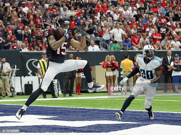 Will Fuller of the Houston Texans catches a pass for a touchdown defended by Perrish Cox of the Tennessee Titans in the first quarter of the NFL game...