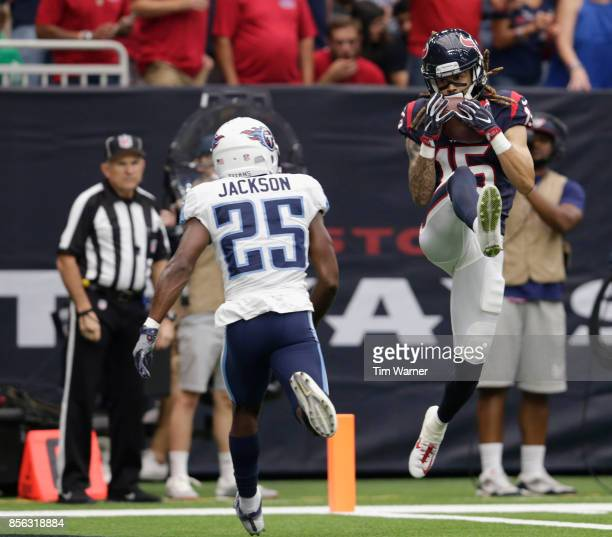 Will Fuller of the Houston Texans catches a touchdown pass defended by Adoree' Jackson of the Tennessee Titans in the second quarter at NRG Stadium...