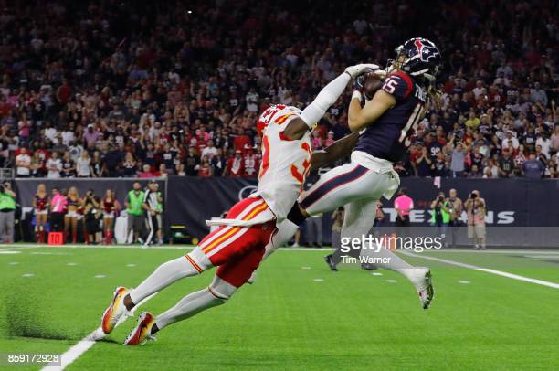 Will Fuller of the Houston Texans catches a touchdown pass defended by Jacoby Glenn of the Kansas City Chiefs in the fourth quarter at NRG Stadium on...