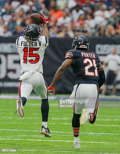 Will Fuller of the Houston Texans drops a pass as Tracy Porter of the Chicago Bears defends during a NFL football game at NRG Stadium on September 11...