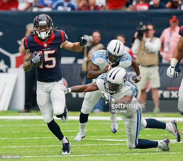 Will Fuller of the Houston Texans runs past Rashad Johnson of the Tennessee Titans and Daimion Stafford after a catch at NRG Stadium on October 2...