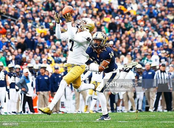 Will Fuller of the Notre Dame Fighting Irish catches a pass before running into the endzone for a touchdown in the second quarter in front of Avonte...