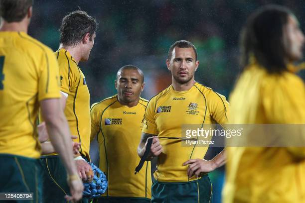 Will Genia and Quade Cooper of the Wallabies look on dejected adter the final whistle during the IRB 2011 Rugby World Cup Pool C match between...
