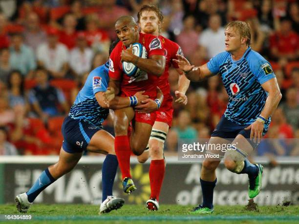 Will Genia of the Reds runs in attack during the round 6 Super Rugby match between the Reds and the Bulls at Suncorp Stadium on March 23 2013 in...