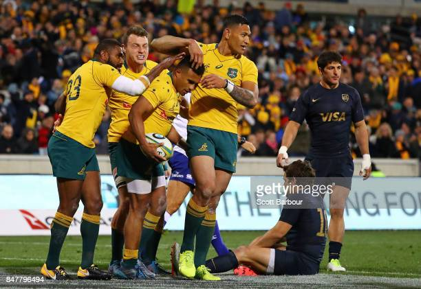 Will Genia of the Wallabies is congratulated by Israel Folau and his teammates after scoring a try during The Rugby Championship match between the...