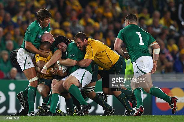 Will Genia of the Wallabies is tackled by Donncha O'Callaghan Paul O'Connell and Mike Ross of Ireland and during the IRB 2011 Rugby World Cup Pool C...