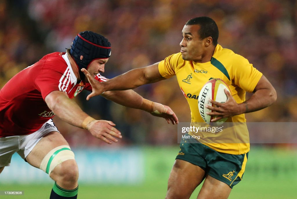 <a gi-track='captionPersonalityLinkClicked' href=/galleries/search?phrase=Will+Genia&family=editorial&specificpeople=4110822 ng-click='$event.stopPropagation()'>Will Genia</a> of the Wallabies makes a break during the International Test match between the Australian Wallabies and British & Irish Lions at ANZ Stadium on July 6, 2013 in Sydney, Australia.