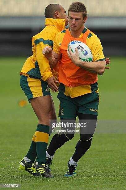 Will Genia tackles Rob Horne of the Wallabies during an Australia IRB Rugby World Cup 2011 training session at North Harbour Stadium on October 19...