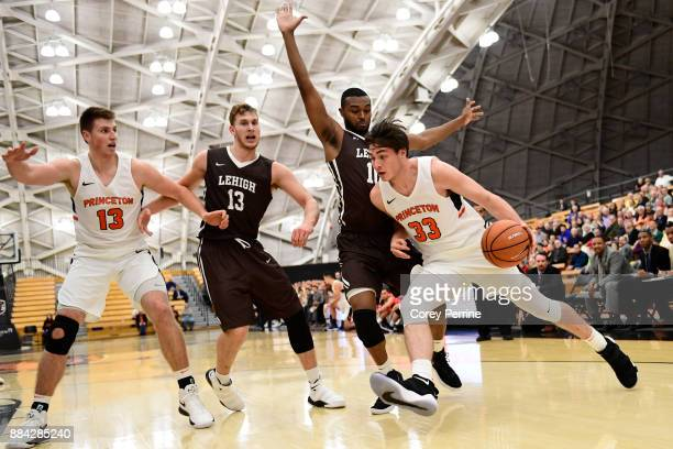 Will Gladson of the Princeton Tigers and James Karnik of the Lehigh Mountain Hawks look on as Ed Porter of the Lehigh Mountain Hawks defends against...