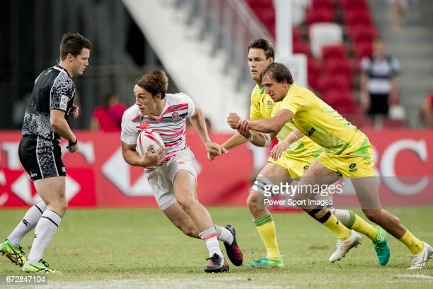 Will Glover of England runs with the ball during the match Australia vs England the Bronze Final of Day 2 of the HSBC Singapore Rugby Sevens as part...