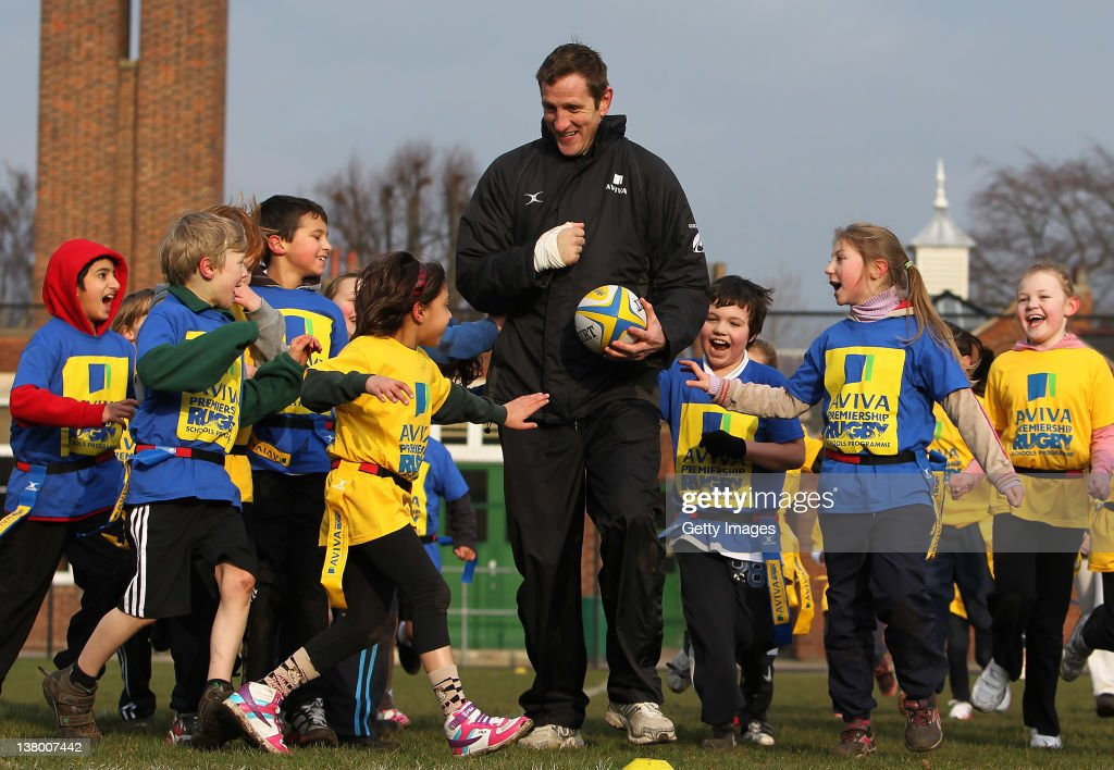 Will Greenwood and children from Bignold School, Norwich take part in a tag rugby session as part of the Aviva Premiership Rugby Schools programme on January 31, 2012 in Norwich, England.