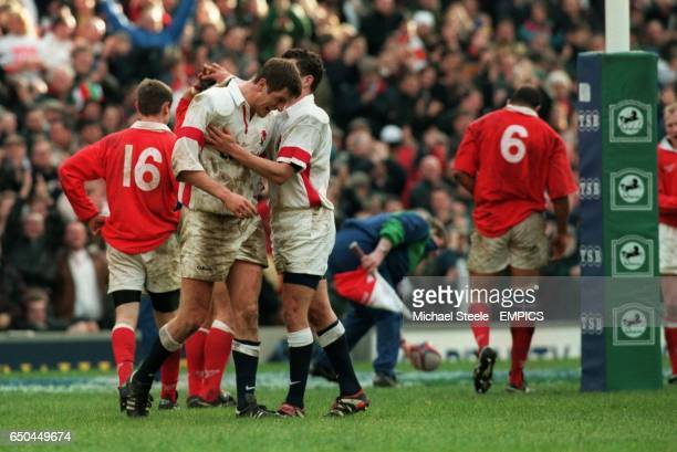 Will Greenwood England celebrate his try with Paul Grayson as Welsh players in the background walk away dejected