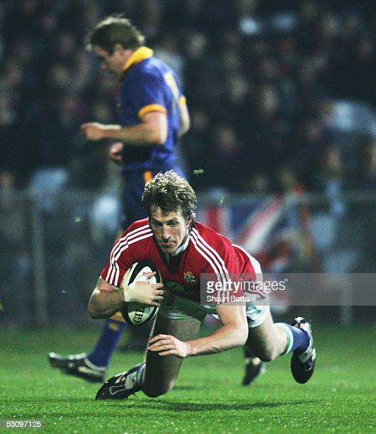 Will Greenwood of the Lions goes over to score during the match between British and Irish Lions and Otago at Carisbrook on June 18 2005 in Dunedin...