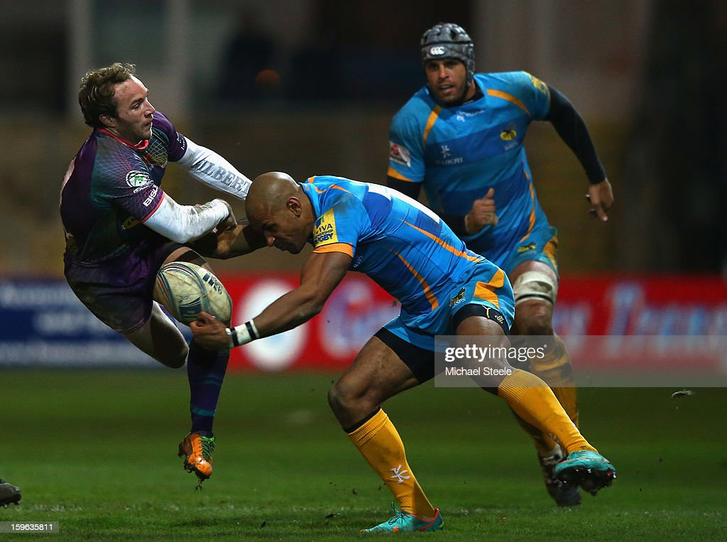 Will Harries (L) of Newport Gwent Dragons challenges Tom Varndell (R) of London Wasps during the Amlin Challenge Cup Pool Three match between Newport Gwent Dragons and London Wasps at Rodney Parade on January 17, 2013 in Newport, Wales.