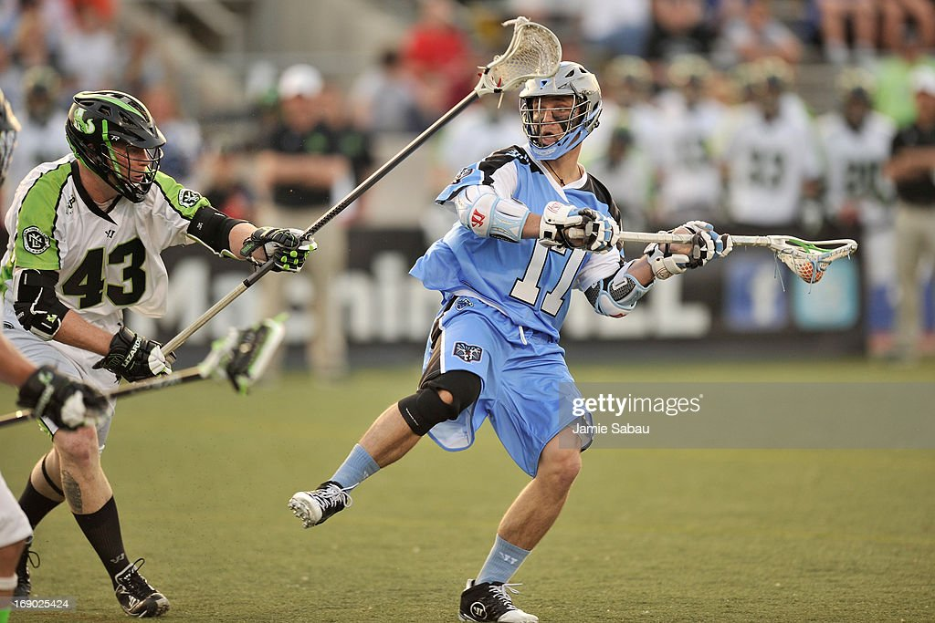 Will Harrington #17 of the Ohio Machine looks to make a pass in the first period as Jack Reid #43 of the New York Lizards defends on May 18, 2013 at Selby Stadium in Delaware, Ohio.