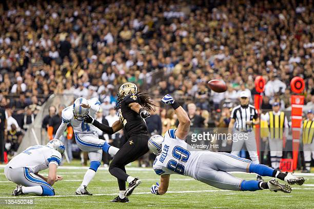 Will Heller of the Detroit Lions blocks on a field goal attempt during a game against the New Orleans Saints at MercedesBenz Superdome on December 4...
