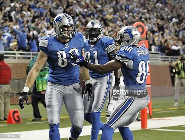 Will Heller of the Detroit Lions celebrates a for a fourth quarter touchdown with Bryant Johnson and Calvin Johnson while playing the Green Bay...