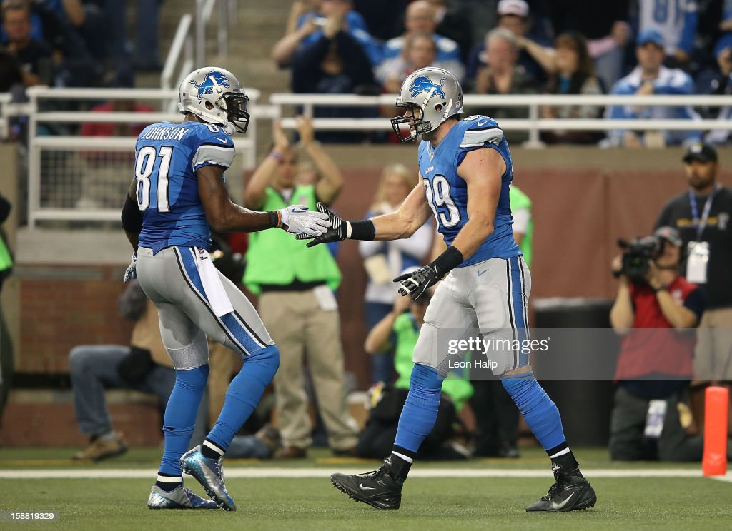 Will Heller #89 of the Detroit Lions celebrates with teammate Calvin Johnson #81 after scoring on a short pass from Matthew Stafford #9 during the third quarter of the game against the Chicago Bears at Ford Field on December 30, 2012 in Detroit, Michigan. The Bears defeted the Lions 26-24.